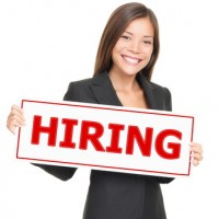 Job woman showing hiring sign.